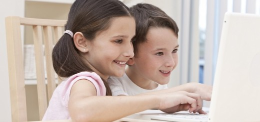 Boy & Girl Children Using Laptop Computer at Home