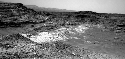 The Martian outcrop where pale rock meets darker overlying rock near the middle of this view is an example of a geological contact. Such contacts can reveal clues about how the environmental conditions that produced one type of rock were related to the conditions that produced the other.  NASA's Curiosity Mars rover took this image with its Navigation Camera (Navcam) just after finishing an uphill drive of about 72 feet (22 meters) on the 991st Martian day, or sol of the rover's work on Mars (May 21, 2015).  Credit: NASA/JPL-Caltech