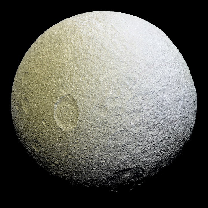 This enhanced-color mosaic of Saturn's icy moon Tethys shows a range of features on the moon's trailing hemisphere. Tethys is tidally locked to Saturn, so the trailing hemisphere is the side of the moon that always faces opposite its direction of motion as it orbits the planet. Credits: NASA/JPL-Caltech/Space Science Institute