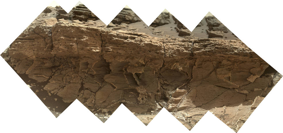 """A rock outcrop dubbed """"Missoula,"""" near Marias Pass on Mars, is seen in this image mosaic taken by the Mars Hand Lens Imager on NASA's Curiosity rover. Pale mudstone (bottom of outcrop) meets coarser sandstone (top) in this geological contact zone, which has piqued the interest of Mars scientists. Credits: NASA/JPL-Caltech/MSSS"""