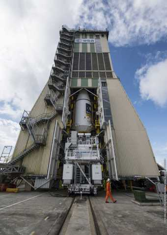 On Monday 7 September 2015 the upper composite containing Galileos 9–10 was transferred to the launch pad, then hoisted up to the top of the Soyuz launch tower to be joined to the other stages. Credit: ESA/CNES/ARIANESPACE-Service Optique CSG