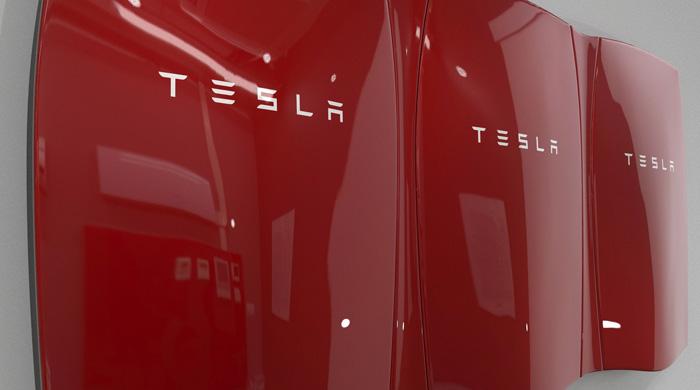 Three Red Tesla Powerwalls